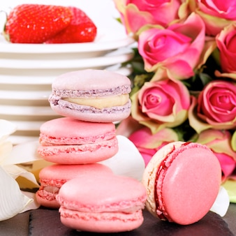 Dessert on valentine's with macaroons, coffee and strawberry