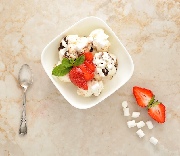 Dessert with ice cream and strawberries with chocolate