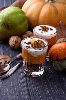 Dessert  with pumpkin and granola. selective focus