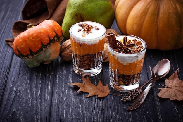 Dessert  with pumpkin and granola. selective focus