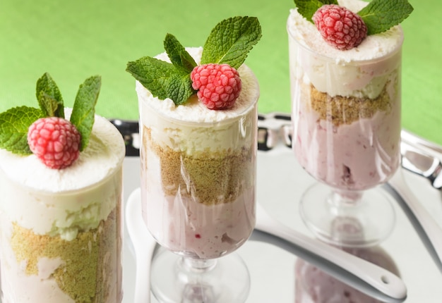 Dessert with raspberry and curd mousse with mint leaves