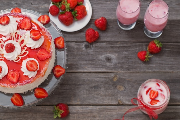 Dessert with strawberries on wooden table