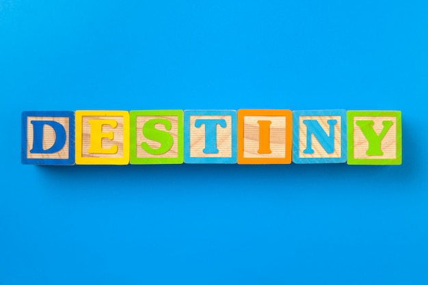 Destiny. wooden colorful alphabet blocks, flat lay, top view.