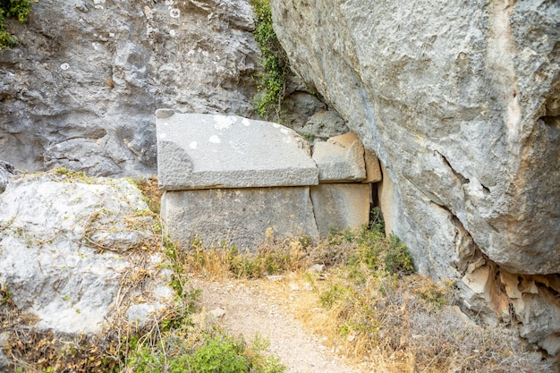 Destroyed greek tombs and ancient burials in the ancient city of termessos near antalya in turkey