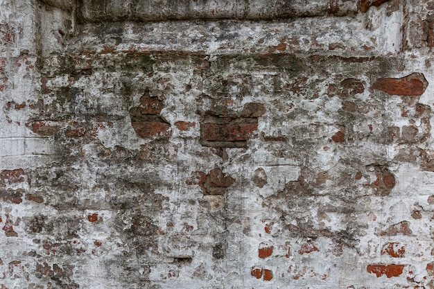 Destroyed surface of a white brick wall. background. space for text.