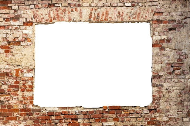 Destroyed wall of old bricks with a hole in the middle. isolated on white background. grunge frame. horizontal frame. high quality photo