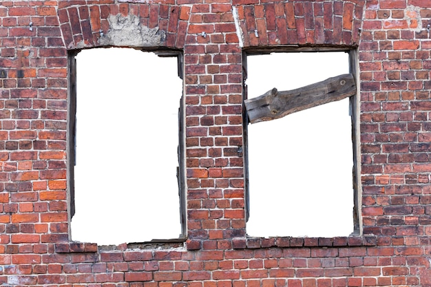 Destroyed wall of old bricks with a hole in the middle. isolated on white background. grunge frame. vertical frame. high quality photo