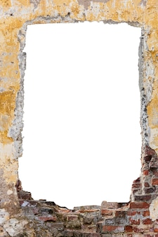 Destroyed wall with a hole in the middle made of red bricks with old paint. isolated on white background. vertical frame. grunge frame. high quality photo