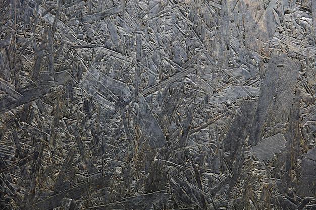 Детализируйте абстрактный фон темной текстуры фанеры