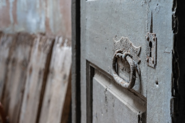 Detail of ancient door in abandoned house