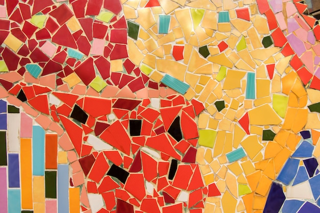 Detail of beautiful old collapsing abstract ceramic mosaic adorned building decorative background, abstract pattern, abstract mosaic colored ceramic stones