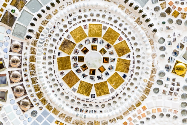 Detail of a beautiful old crumbling abstract ceramic mosaic decoration was destroyed building