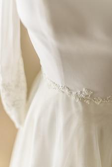 Detail of beautiful wedding dress, premiered valentines day.