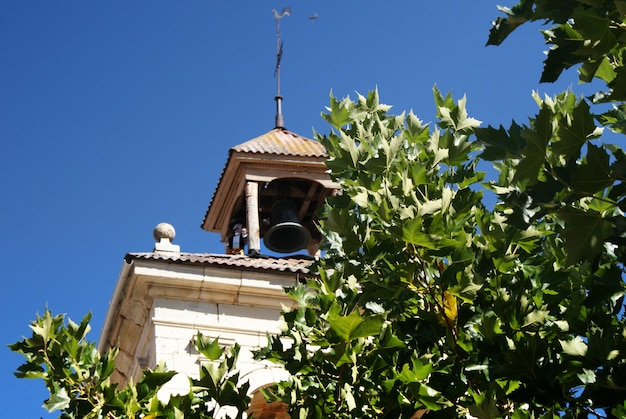 Detail of the bell tower of the church of boñar spain