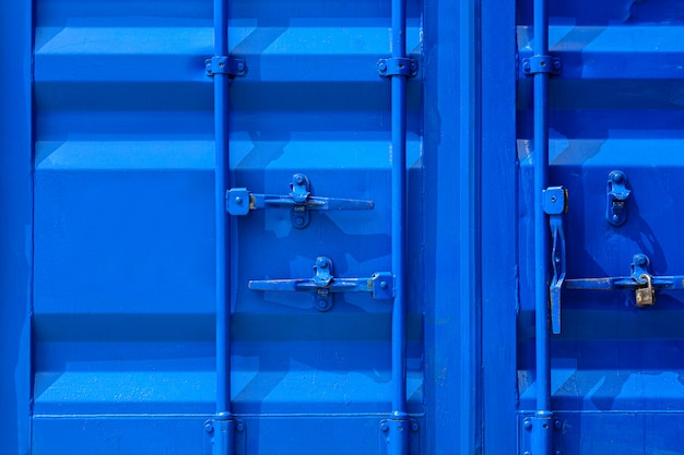 Detail of blue industrial shipping container door.