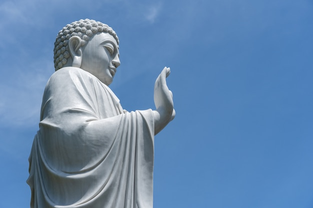 Detail of buddha statue in a buddhist temple and blue sky in danang, vietnam