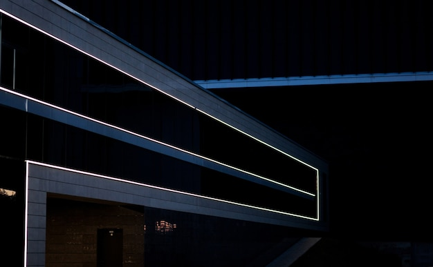 Detail of a building facade with illuminated. abstract architecture background