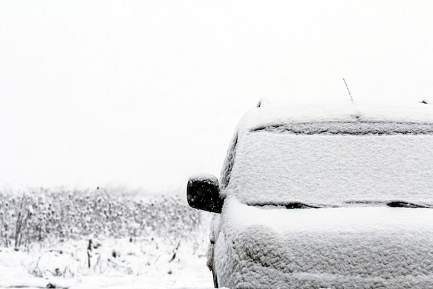 Detail of a car on the street during snow fall in winter