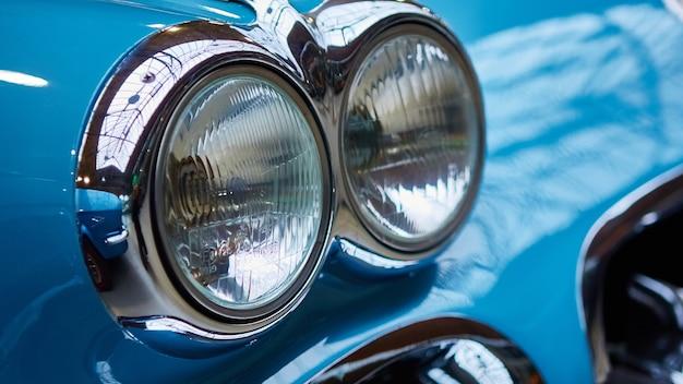 Detail of classic car. closeup of headlight.