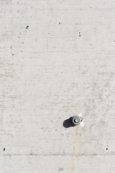 Detail of concrete background texture and screw and nut.