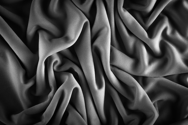 Detail of crumpled fabric texture in black and white with soft lighting.