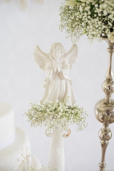 Detail of decoration, flowers and angelic - baptism