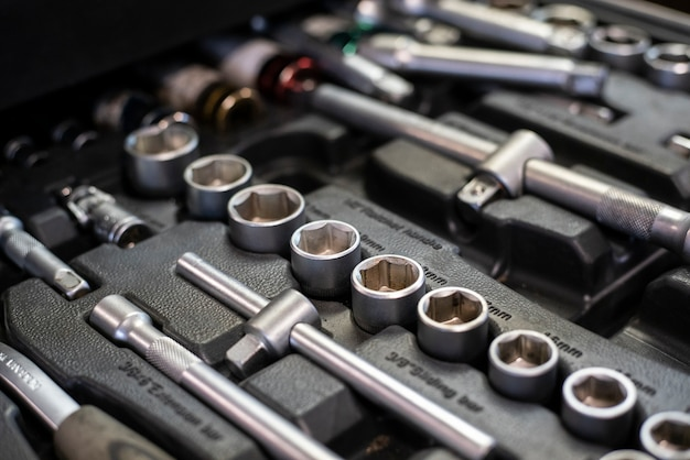 Detail of drawer with socket wrenches in a workshop