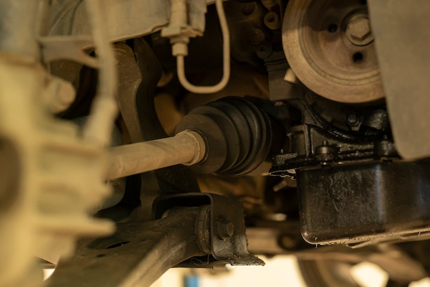 Detail of a drive shaft of the car while it is being repaired