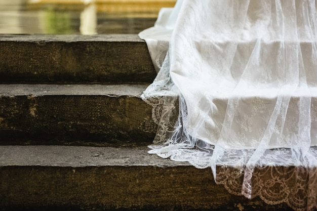Detail of the fabric of a white wedding dress.