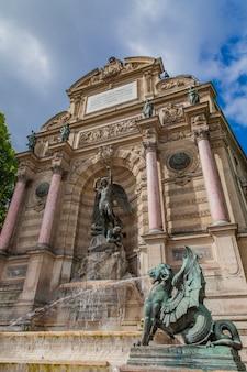 Detail of fontaine saint michel in paris, france