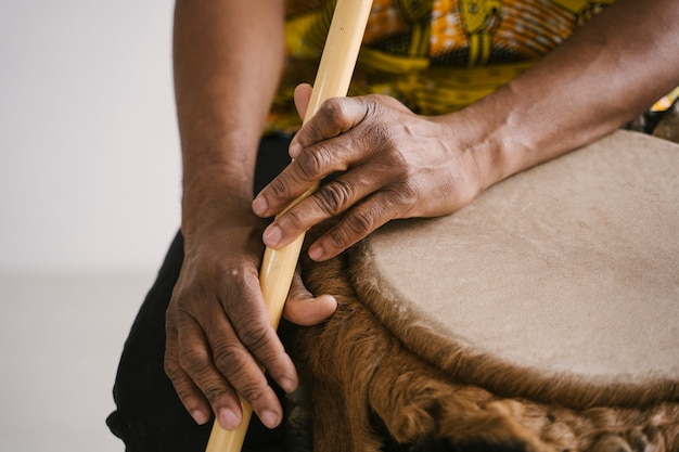 Detail of hands of african american man musician playing the flute with copy space. online music class learning musical instruments. rhythm and blues style. ethnic culture and traditions.