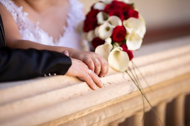 Detail of the hands of a couple with wedding rings