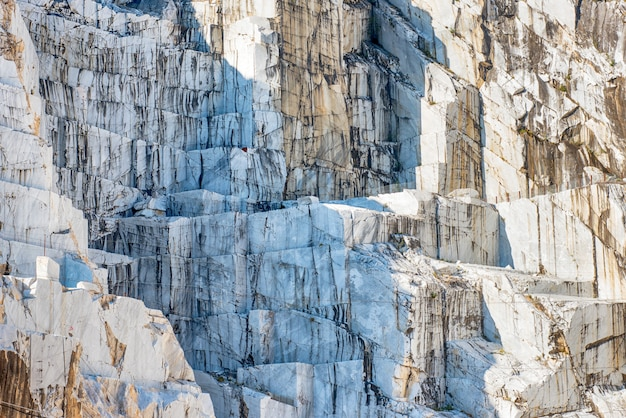 Detail of an italian marble quarry rock face