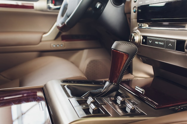 Detail of modern car interior, gear stick, automatic transmission in expensive car.