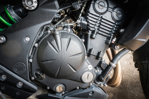 Detail of modern motorcycle engine with stain from raindrop. select focus