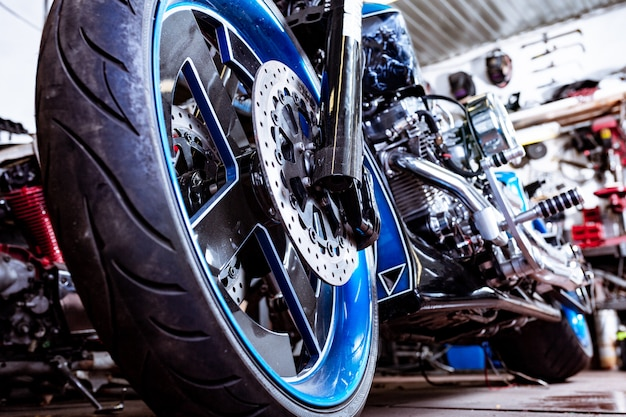 Detail on a modern motorcycle in the workshope. motorcycle exhaust.