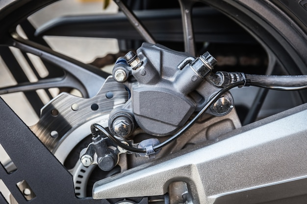 Detail of motorcycle back disc brakes system, close up image