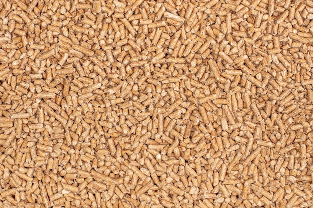 Detail of natural wood pellets background