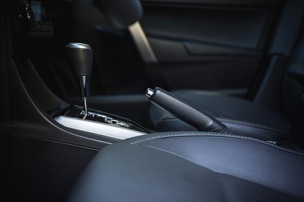 Detail of new modern car interior, focus on hand break