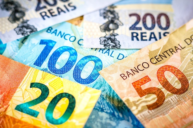 The detail of the notes of two hundred one hundred fifty and twenty reais the real is the currency of brazil