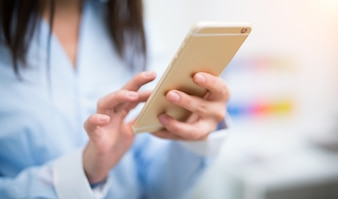 Detail of a woman using her smartphone