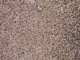 Detail of surface texture with small pebble .