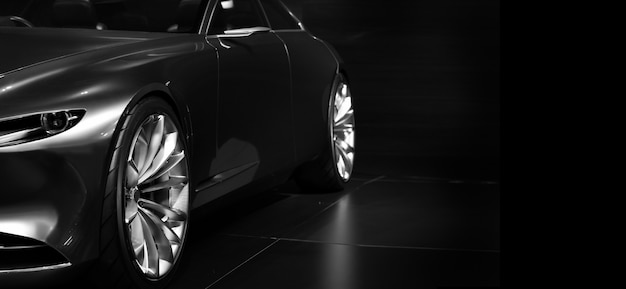 Деталь передних светодиодных фар современного автомобиля на черной стене, свободное место с правой стороны для текста.