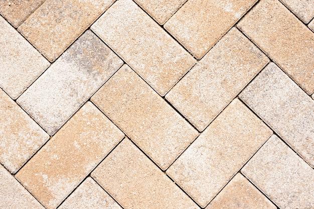 거리의 타일 세부 사항은 조화 패턴을 제공합니다. 벽돌 텍스처와 배경입니다. 석판 포장