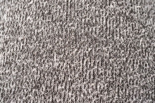 ウールのデザインテクスチャーのディテール。生地の灰色の背景。灰色の杢生地