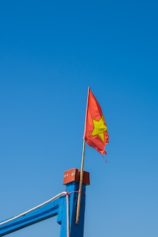 Detail of an old vietnamese flag flying