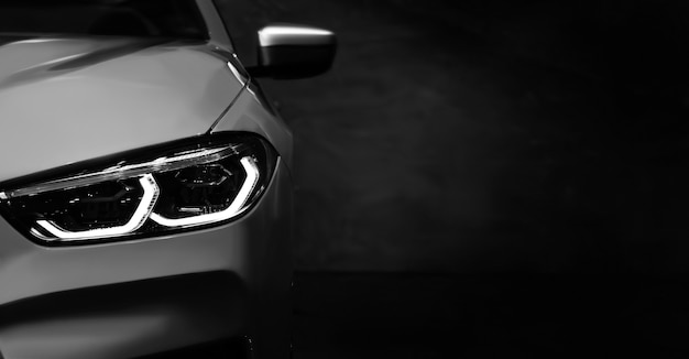 Detail on one of the led headlights modern car black and white for copy space