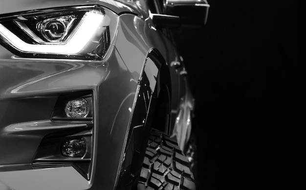 Detail on one of the led headlights pickup truck black and white tone