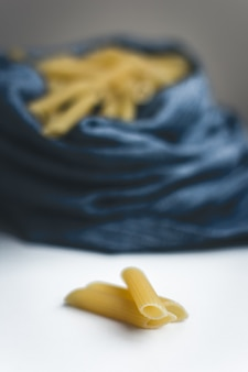 Detail of pasta penne on a white background
