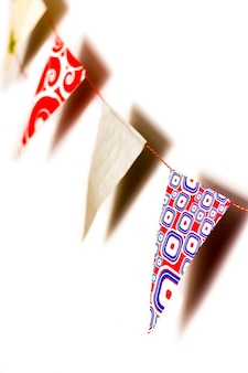 Detail of pattern triangles in a bunting flags with shadows on white background